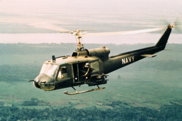 American Gunners Firing from Helicopter in Vietnam