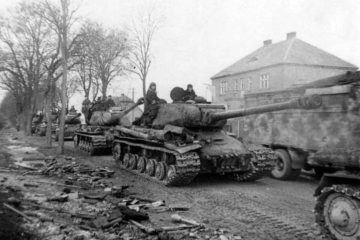 Column of Soviet IS-2 tanks on the road in East Prussia, 1st Belorussian Front. On the left side of the road - abandoned German Panzerfaust.