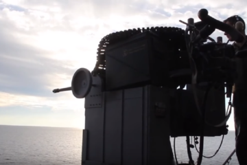US Sailors Firing the Powerful Mk38/ M242 Bushmaster on a Boat