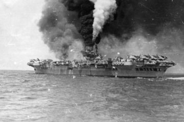 Footage from the British Pacific Fleet off Sakishima Gunto, including a kamikaze run on HMS Indomitable. One clip shows HMS Indefatigable burning after being hit on the armoured deck alongside the island